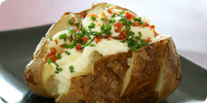 Chopped herbs on baked potato