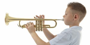 Boy playing music with his trumpet