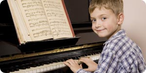 Boy playing with his piano