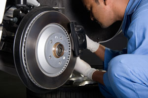 Mechanic repairs brake pads