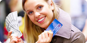 Woman with cash and credit card