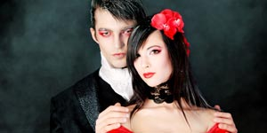 Couple with Halloween make up and costumes