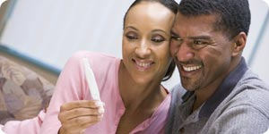 Happy couple with pregnancy kit test