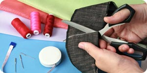 Cutting fabric with scissors