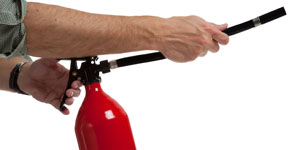 Using fire extinguisher