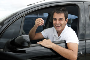 Man with his new car