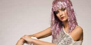 Young woman in sequins and shiny wig