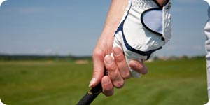 Golfer doing the interlock grip