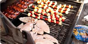 Grilling kabobs, hot dogs and chicken