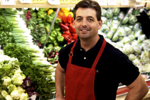 Grocery clerk standing in produce section