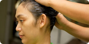 Woman having hair treatment