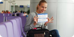 Woman showing her plane ticket