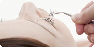 Applying eyelash extensions