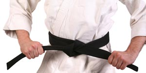 Man with black belt in karate costume