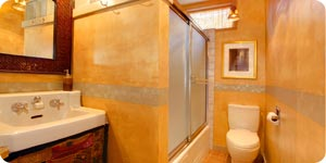 Artistic orange colored bathroom