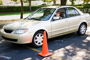 Teen taking a parallel parking test