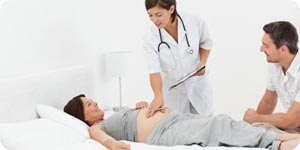 Pregnant woman with husband and nurse