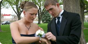 Boy giving his date a corsage