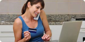 Girl shopping online using credit card