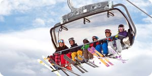 Group of people riding the snow lift