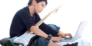 Boy with guitar and laptop