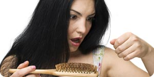 Surprised woman holding comb