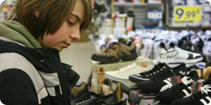 Teen shopping for shoes