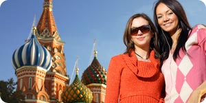 Woman taking a picture at Saint Basil's Cathedral in Moscow
