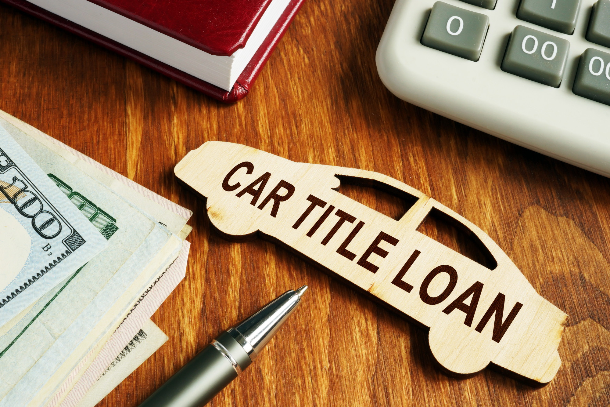 car title loan concept on wooden car model