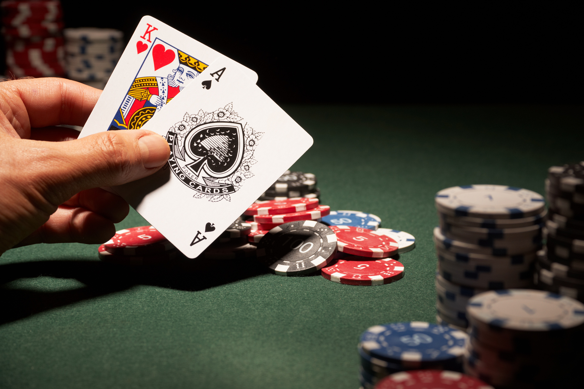King of hearts and ace of spades cards with casino chips