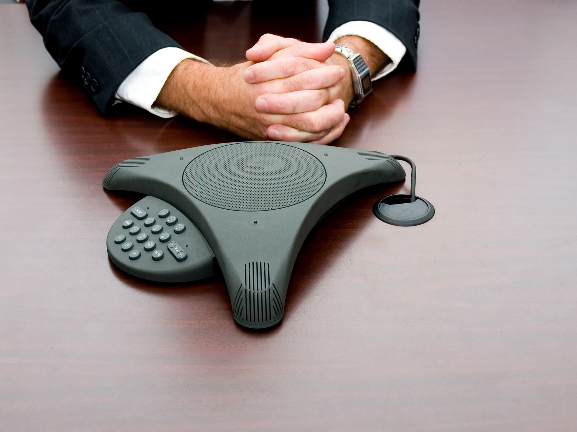 businessman in meeting with conference call equipment