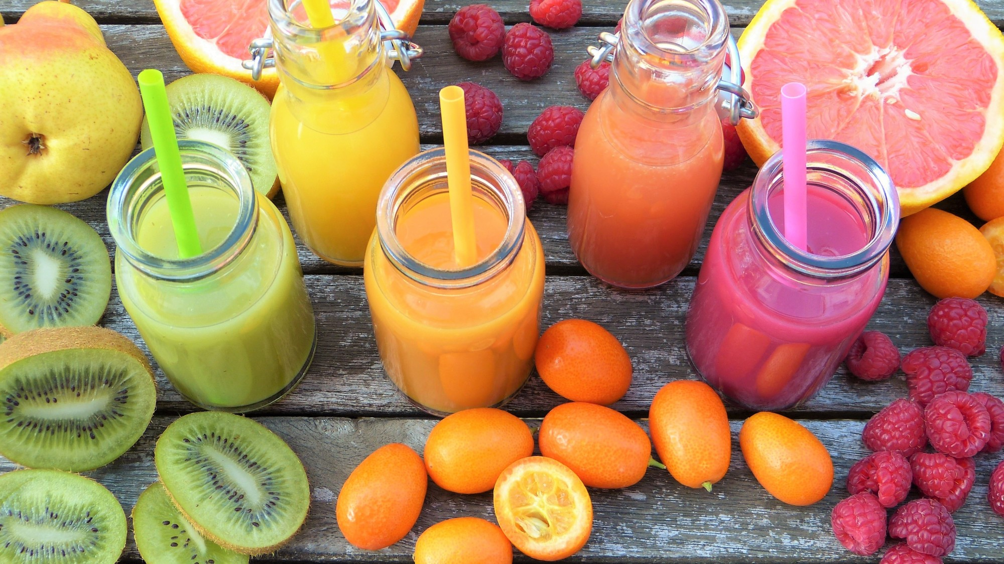 tropical fruits and smoothies in table