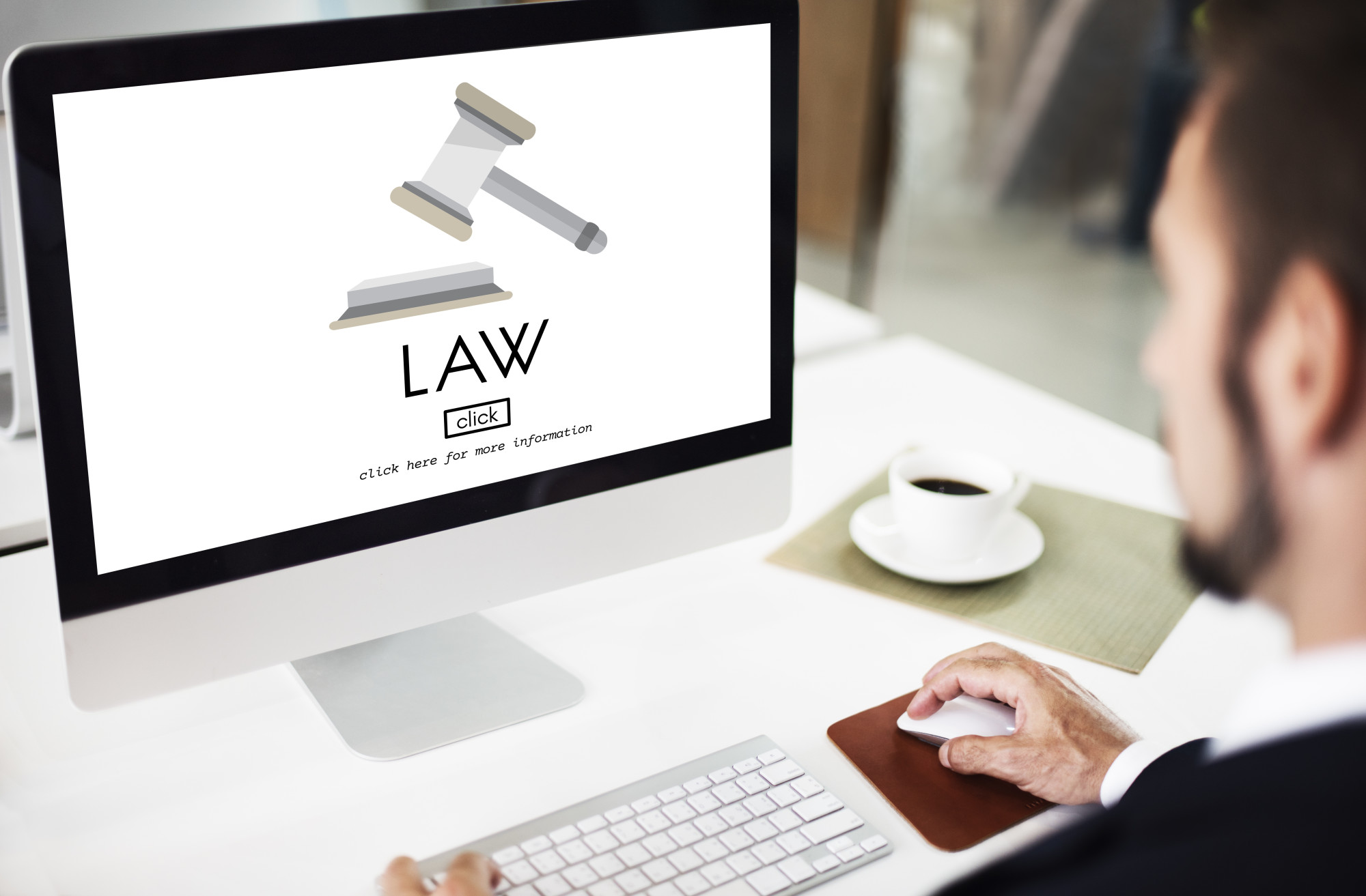 lawyer browsing law firm website on desktop computer