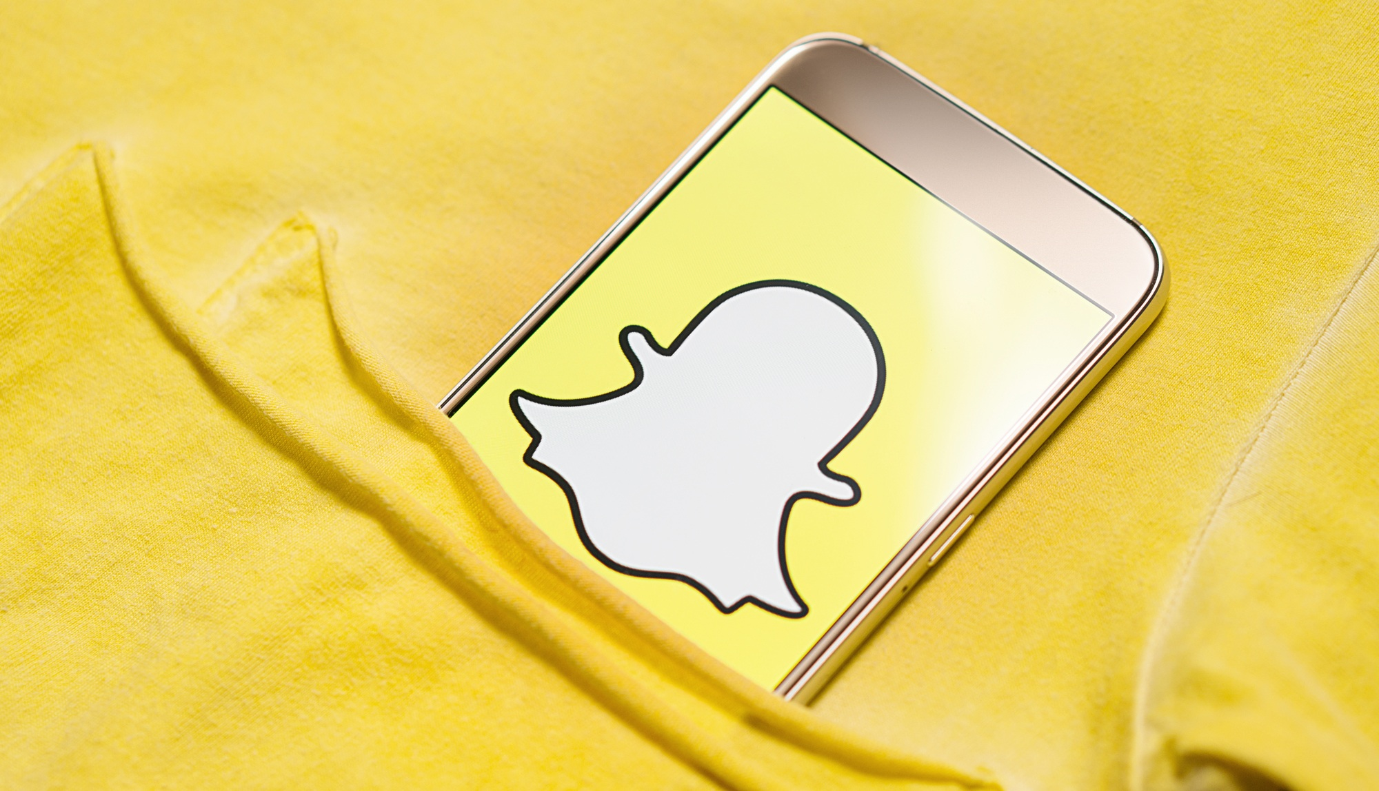 snapchat logo on smartphone screen