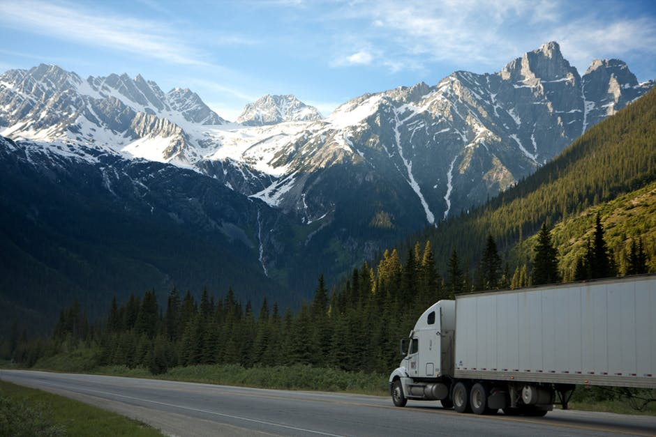 big truck driving on picturesque mountain highway
