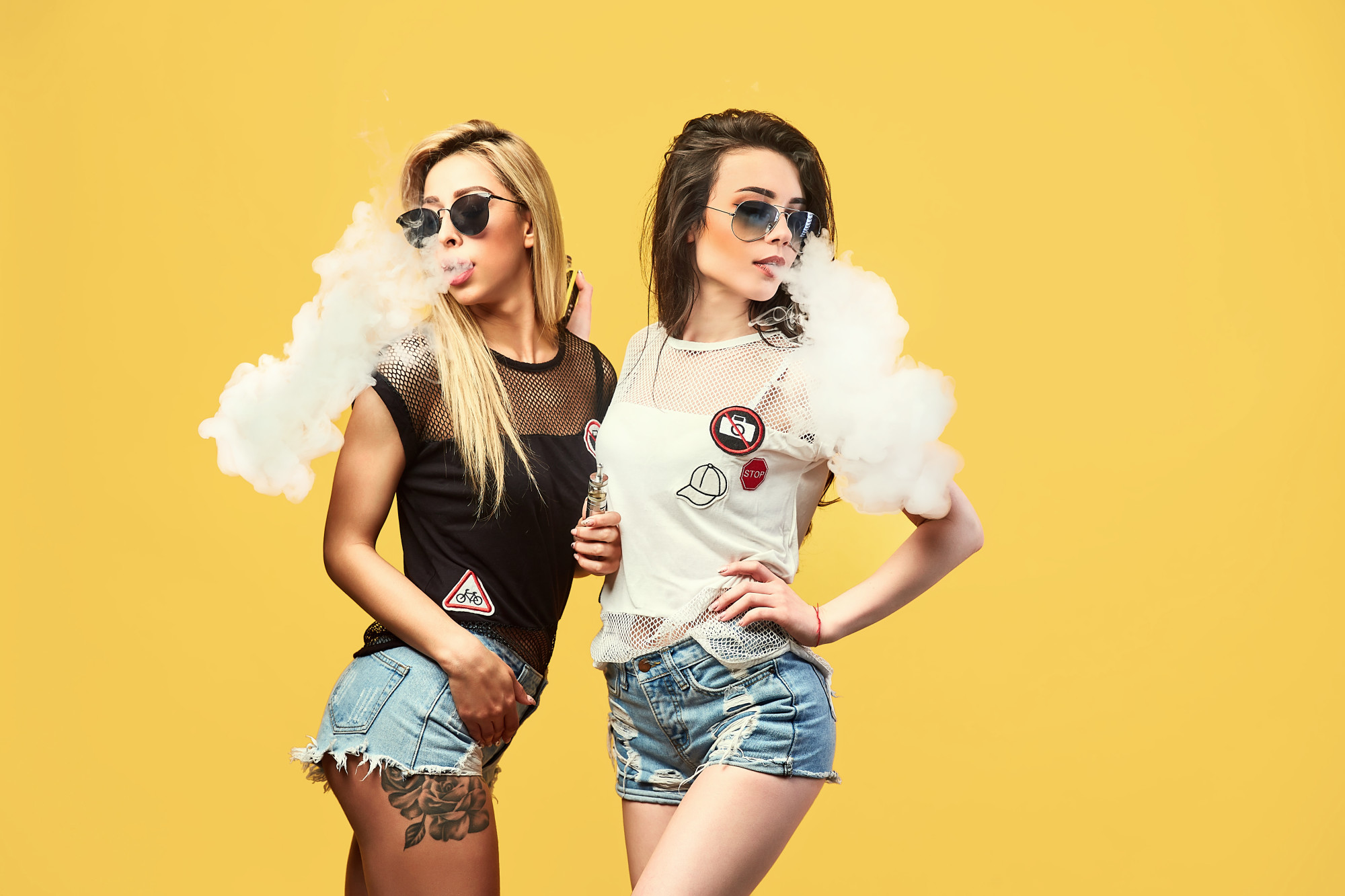 two young, sexy women vaping