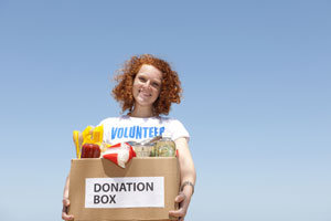 Happy volunteer with a donation box