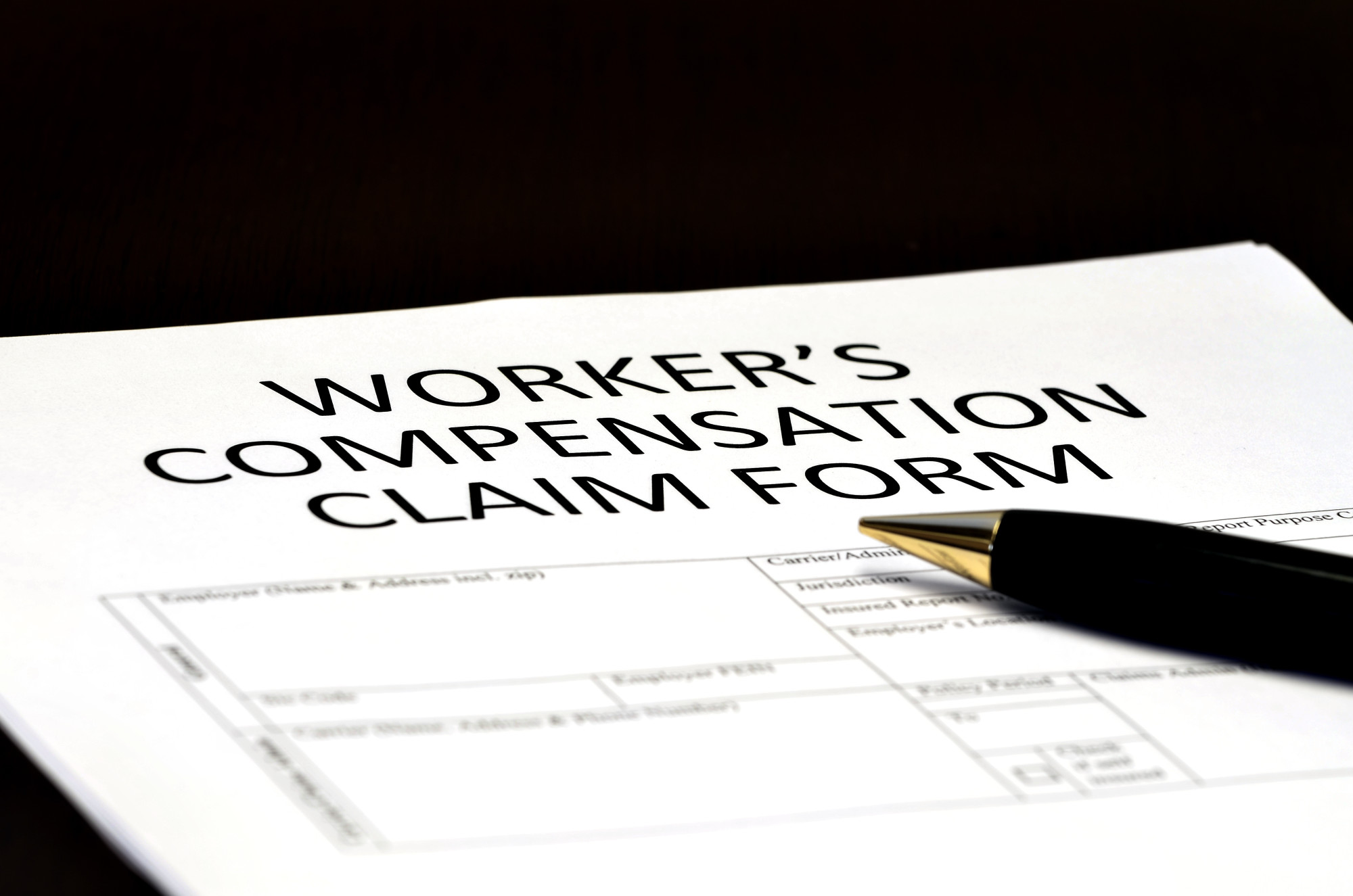 worker's compensation form in black background